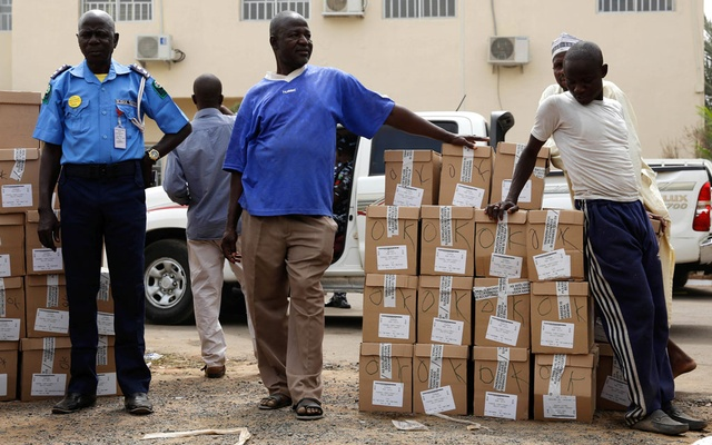 Ad-hoc staff wait to load election materials onto a truck for distribution in Yola, in Adamawa State, Nigeria Feb 15, 2019. REUTERS/Nyancho NwaNri