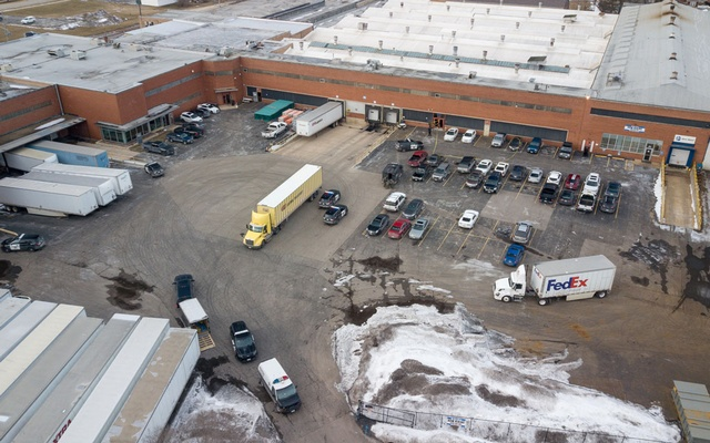 An aerial photo of police and emergency vehicles parked in a lot adjacent to a warehouse at the scene of a mass shooting involving multiply casualties in Aurora, Illinois, US, Feb 15, 2019. Bev Horne/Daily Herald/via REUTERS