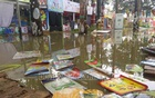 A thunderstorm drenched the Ekushey Book Fair on Sunday, damaging the various stalls. Photo: Mostafigur Rahman