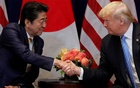 US President Donald Trump greets Japan's Prime Minister Shinzo Abe during a bilateral meeting on the sidelines of the 73rd session of the United Nations General Assembly in New York, US, Sep 26, 2018. REUTERS