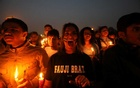 People attend a candle light vigil to pay tribute to Central Reserve Police Force (CRPF) personnel who were killed after a suicide bomber rammed a car into the bus carrying them in south Kashmir on Thursday, in front of India Gate war memorial in New Delhi, India, February 16, 2019. Reuters