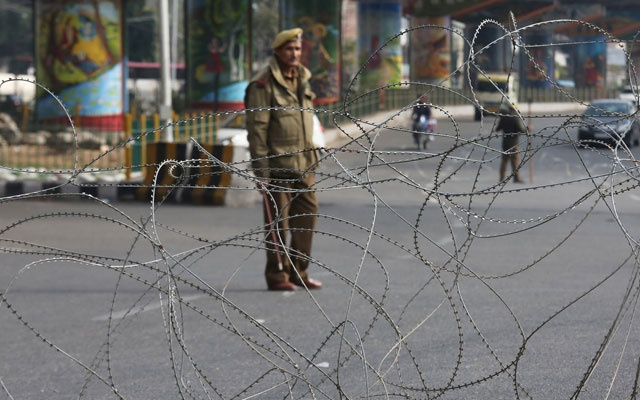 A policeman stands guard at a street during a curfew in Jammu, Feb 17, 2019. REUTERS