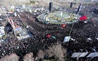 Iranian people along with members of Iran's elite Revolutionary Guards gather around the coffins of Iran's elite Revolutionary Guards, who were killed by a suicide car bomb, during the funerals in Isfahan, Iran February 16, 2019. Morteza Salehi/Tasnim News Agency/via REUTERS