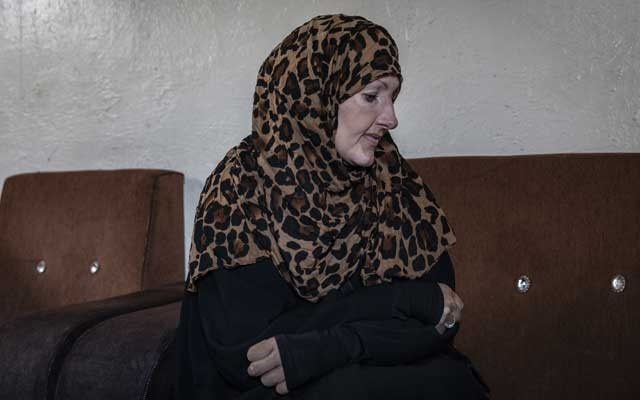 "Kimberly Polman, who was born into a Mennonite community in Canada and traveled to live in the Islamic State group's self-declared caliphate, at the Al Hawl detention camp in Syria, Feb. 17, 2019. Polman and another woman say they haven't been questioned, or even visited by American officials in the month since they surrendered. ""I don't have words for how much regret I have,"" Polman said. (Ivor Prickett/The New York Times)"