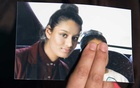 FILE PHOTO: Renu Begum, sister of teenage British girl Shamima Begum, holds a photo of her sister as she makes an appeal for her to return home at Scotland Yard, in London, Britain February 22, 2015. Reuters