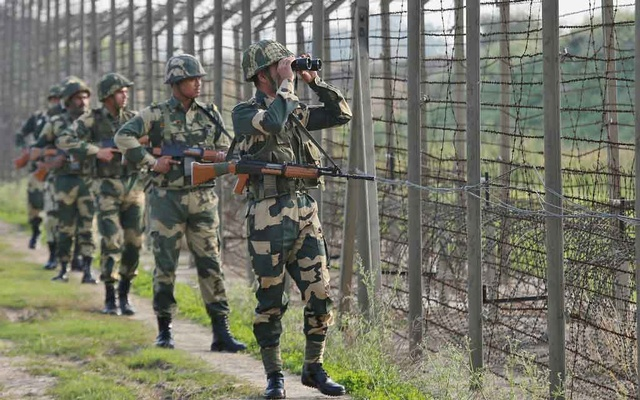 India's Border Security Force (BSF) soldiers patrol along the fenced border with Pakistan in Ranbir Singh Pura sector near Jammu Feb 26, 2019. REUTERS