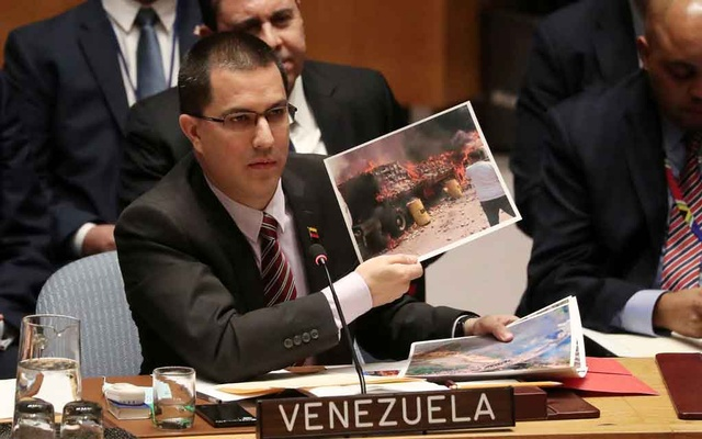 Venezuela Minister of Foreign Affairs Jorge Arreaza holds a picture while speaking during the United Nations Security Council meeting about the situation in Venezuela in New York, US, February 26, 2019. REUTERS