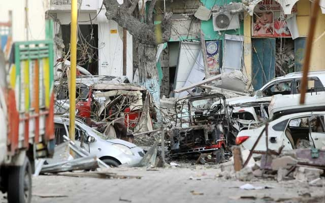 Damaged cars are seen at the scene where a suicide car bomb exploded targeting a Mogadishu hotel in a business centre in Maka Al Mukaram street in Mogadishu, Somalia Mar 1, 2019. REUTERS