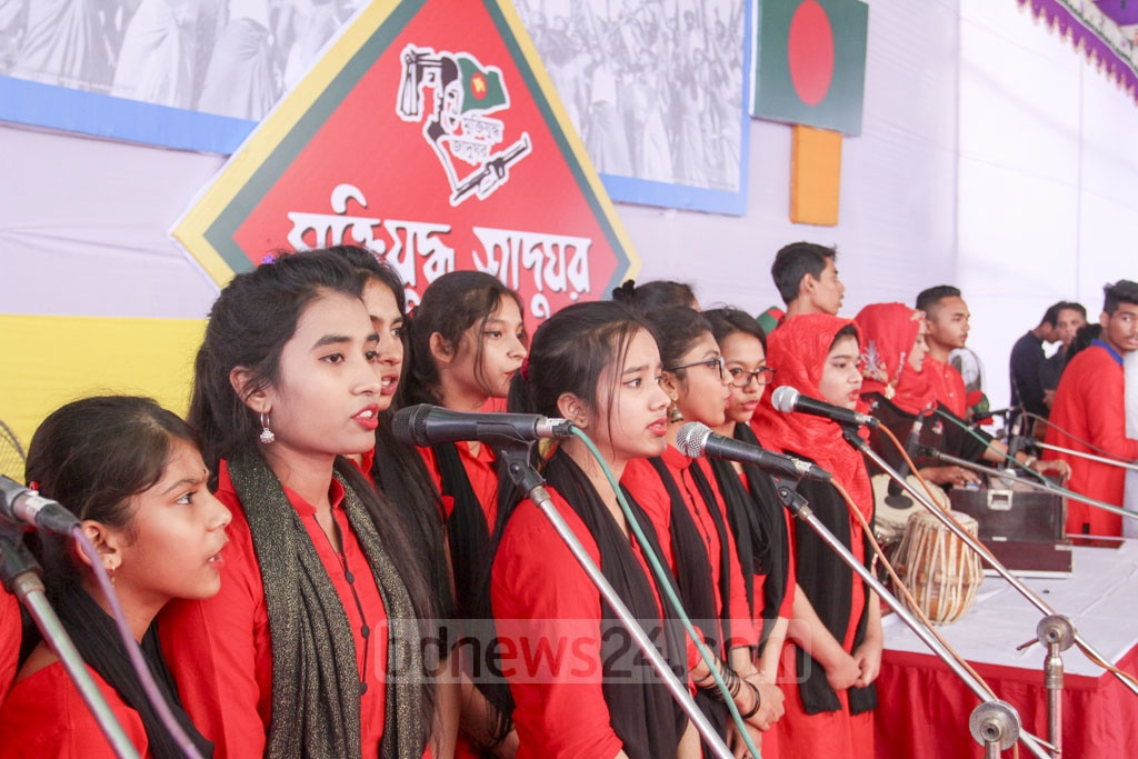 A group of young artists perform on stage for 'Muktir Utshob', an event organised by the Liberation War Museum on Dhaka University campus on Friday. Photo: Asif Mahmud Ove