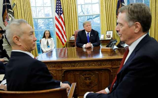 FILE PHOTO: US President Donald Trump looks on during a meeting with China's Vice Premier Liu He and US Trade Representative Robert Lighthizer (R) in the Oval Office at the White House in Washington, US, Feb 22, 2019. REUTERS/Carlos Barria/File Photo