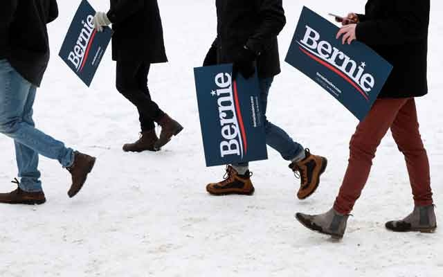 People arrive to watch US Presidential Candidate and Vermont Senator Bernie Sanders speak at a rally at Brooklyn College in New York, US, March 2, 2019. REUTERS/Andrew Kelly