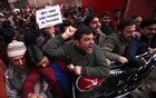 Activists of National Conference party, one of the Kashmir's main pro-India political parties, shout slogans during a protest against what the activists say is attacks on Kashmiris living outside their state, in Srinagar February 23, 2019. Reuters