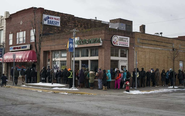 Customers line up at the New Palace Bakery, on Fat Tuesday in Hamtramck, Mich., March 5, 2019. Though the Polish families that once dominated this two-square-mile enclave of Detroit have largely been replaced by immigrants from Muslim countries, Paczki Day remains a vital all-day event in Hamtramck. (Brittany Greeson/The New York Times)