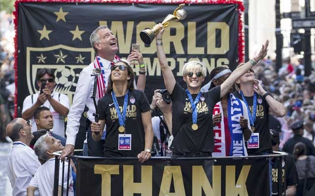 Carli Lloyd and Megan Rapinoe with other members of the US women's soccer team make their way down the Canyon of Heroes during a ticker-tape parade in their honour for winning the World Cup, in New York, July 10, 2015. The New York Times