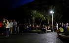 People queue outside a pharmacy to try to buy goods during a blackout in Caracas, Venezuela Mar 8, 2019. REUTERS