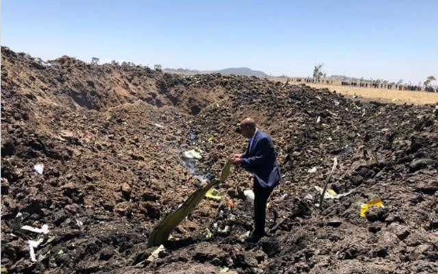 A photo provided by Ethiopian Airlines of Tewolde Gebremariam, the chief executive of the airlines, at the site of the plane crash in Ethiopia. The New York Times