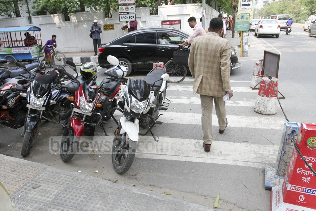 Motorcyclists parked on a zebra crossing leaving no place for pedestrians on Road No. 3 at Dhaka's Gulshan-1. Photo: Asif Mahmud Ove