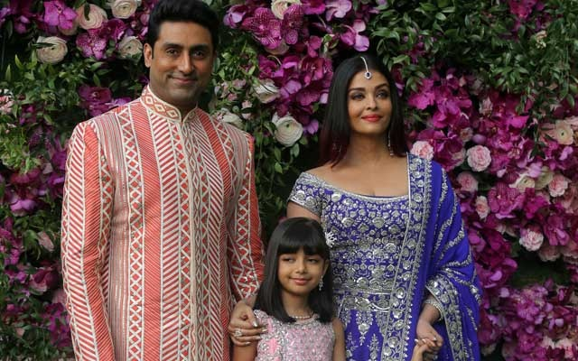Actor Abhishek Bachchan, his wife actress Aishwarya Rai and their daughter Aaradhya pose during a photo opportunity at the wedding ceremony of Akash Ambani, son of the Chairman of Reliance Industries Mukesh Ambani, at Bandra-Kurla Complex in Mumbai, India, Mar 9, 2019. REUTERS