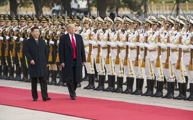 President Donald Trump and President Xi Jinping of China in Beijing. REUTERS