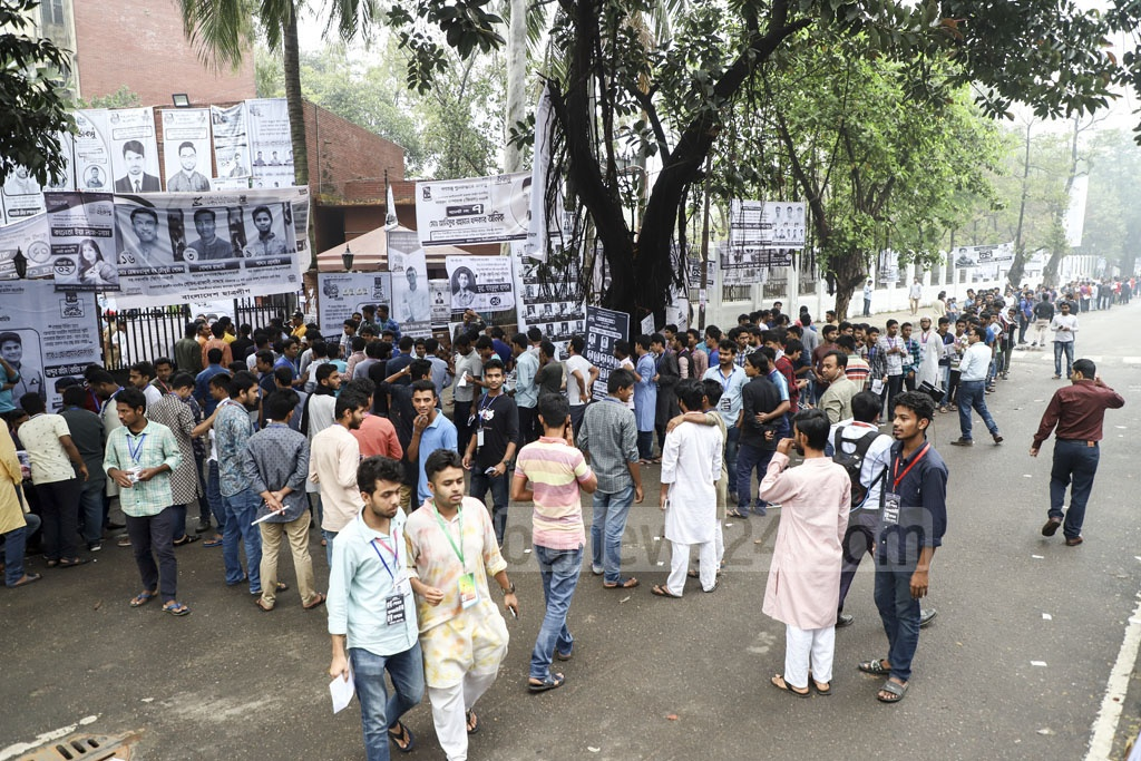 Long lines of voters queue in front of AF Rahman Hall for the Dhaka University Central Students Union (DUCSU) and hall council polls. Long lines of voters were seen in front of the polling centres at Dhaka University long before they opened at 8 am. Photo: Abdullah Al Momin
