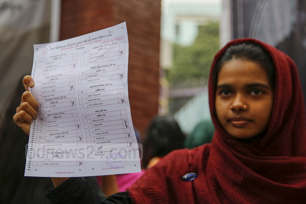 Students discovered sacks of marked ballots for the Hall Council elections before the DUCSU polls opened at Bangladesh-Kuwait Maitree Hall on Monday, leading to protests. A student shows the marked ballot paper to the camera. Photo: Mostafigur Rahman