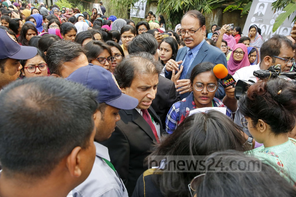 Dhaka University Proctor AKM Golam Rabbani is surrounded by protesting students after the discovery of marked Hall Council ballot papers at Bangladesh-Kuwait Maitree Hall on Monday before DUCSU polls opened. Photo: Mostafigur Rahman