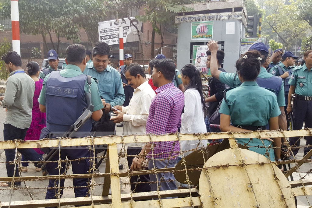 Identification papers are inspected at entry routes to the Dhaka University area on Monday during the DUCSU polls.