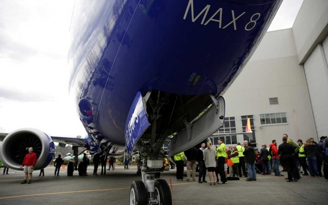FILE PHOTO: Boeing employees are pictured in front of a 737 MAX 8 produced for Southwest Airlines as Boeing celebrates the 10,000th 737 to come off the production line in Renton, Washington, US, March 13, 2018. Reuters