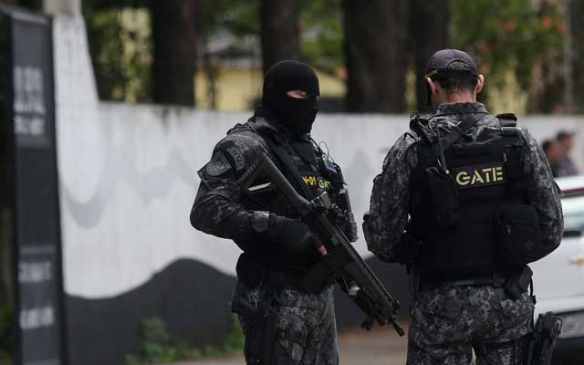 Policemen are seen at the Raul Brasil school after a shooting in Suzano, Sao Paulo state, Brazil March 13, 2019. Reuters
