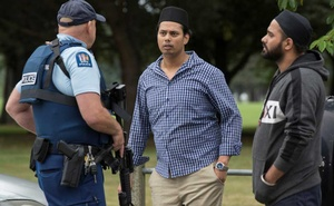 Witnesses and police at the south end of Deans Avenue after a shooting incident at the Al Noor mosque in Christchurch, New Zealand, March 15, 2019. Reuters