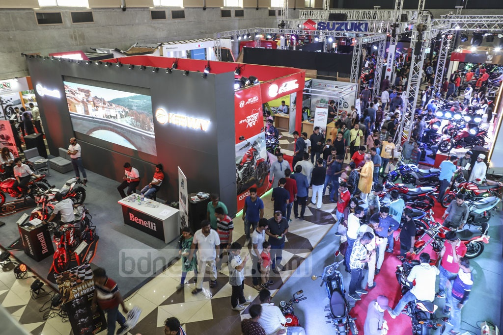 Visitors crowdong the Dhaka Motor Show at the International Convention City Bashundhara in Dhaka on Friday