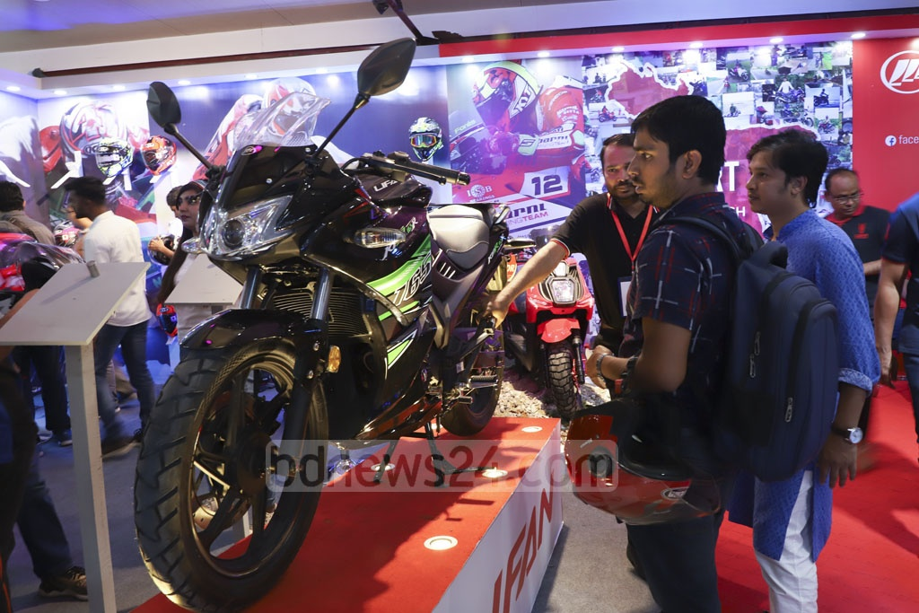 Visitors crowded a Dhaka Motor Show stall at the International Convention City Bashundhara in Dhaka on Friday