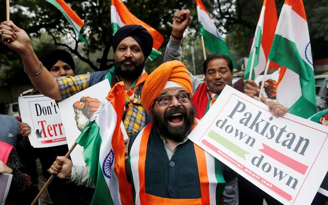FILE PHOTO: People hold national flags and placards as they celebrate after Indian authorities said their jets conducted airstrikes on militant camps in Pakistani territory, in New Delhi, India, Feb 26, 2019. REUTERS/Adnan Abidi/File Photo