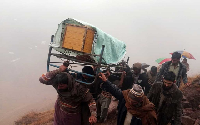 Men and relatives carry the coffin of Sudheer Qureshi, a boy whom mourners say was killed by shelling fired from Indian Administered Kashmir, during a funeral in Jehlum Valley in Pakistan Administered Kashmir, Pakistan Mar 2, 2019. REUTERS/M Saif-ul-Islam