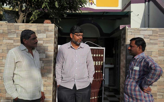 Altaf Khokhar, son of Mahebubbhai Khokhar who was killed in Friday's mosque attacks in New Zealand, speaks with his neighbours outside his home in Surendranagar in the western state of Gujarat, India, March 17, 2019. Reuters