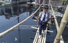 Children walk over the risky bamboo bridges, which have often led to accidents. Photo: Abdullah Al Momin