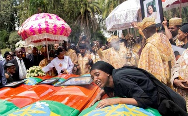 A woman mourns next to coffins during the burial ceremony of the Ethiopian Airline Flight ET 302 crash victims at the Holy Trinity Cathedral Orthodox church in Addis Ababa. REUTERS