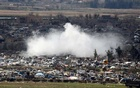 Smoke rises from the last besieged neighborhood in the village of Baghouz, Deir Al Zor province. REUTERS