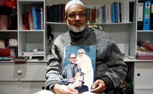 Al Noor mosque shooting survivor Farid Ahmed poses with a photo of his wife Husna, who was killed in the attack, after an interview with Reuters in Christchurch, New Zealand March 18, 2019. Reuters