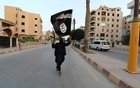 File Photo: A member loyal to the Islamic State in Iraq and the Levant (ISIL) waves an ISIL flag in Raqqa, Syria Jun 29, 2014. REUTERS