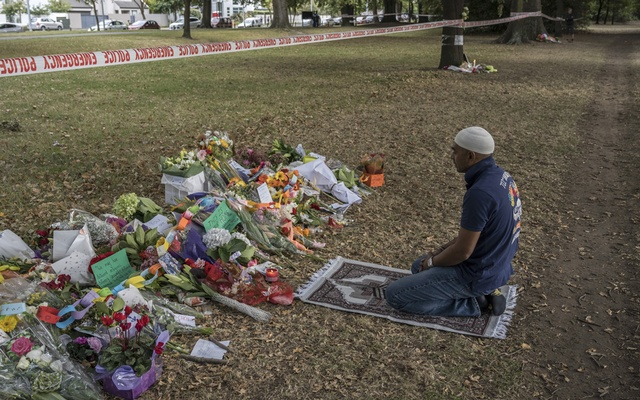 A man who said he frequented the Al Noor Mosque, but was away when a mass shooting occurred there days ago, prays at a makeshift memorial in front of the building, on Tuesday morning, March 19, 2019. Prime Minister Jacinda Ardern on Monday ordered an inquiry into what government officials could have known about the gunman before he carried out an attack on two mosques that left 50 people dead. (Adam Dean/The New York Times)