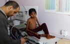 Yemen hunger: A nurse weighs Afaf Hussein, 10, who is malnourished, at the malnutrition treatment ward of al-Sabeen hospital in Sanaa, Yemen, Jan 31, 2019. Afaf, who now weighs around 11 kg and is described by her doctor as