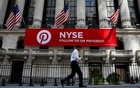 FILE PHOTO: A Pinterest banner hangs on the facade of the New York Stock Exchange (NYSE) in New York City, US, September 22, 2017. Reuters