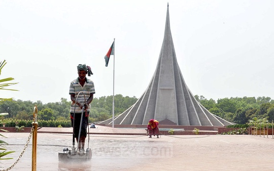 Workers cleaning the National Memorial at Savar on the outskirts of the capital on Sunday as it is getting prepared for the people to pay their respects the Independence Day.