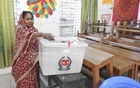 A woman casts her ballot in the third phase of the Upazila Parishad elections on Sunday. Voting began in 117 upazilas in 25 districts in this phase of the elections, but was later suspended at one upazila.
