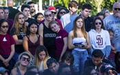 FILE PHOTO - Students attend a poetry reading at a memorial garden on the anniversary of the mass shooting at Marjory Stoneman Douglas High School in Parkland, Fla., Feb. 14, 2019. On Saturday, for the second time in a week, a young person who attended Marjory Stoneman Douglas High School during the mass shooting in February 2018 was found dead in an apparent suicide. (Saul Martinez/The New York Times)