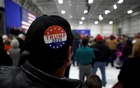 FILE PHOTO: A man wears a Trump 2020 campaign button as US President Donald Trump speaks in support of Republican congressional candidate Rick Saccone during a Make America Great Again rally in Moon Township, Pennsylvania, US, Mar 10, 2018. REUTERS/Joshua Roberts/File Photo/File Photo