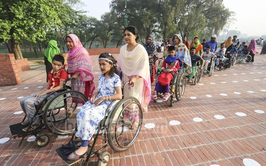 People with physical disabilities join a procession to pay tribute to martyrs of the Liberation War on Independence Day. Photo: asif mahmud ove