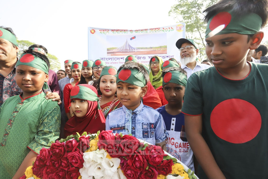 Children, accompanied by their parents and guardians, pay tribute to the martyrs of the Liberation War in honour of Independence Day on Tuesday. Photo: asif mahmud ove