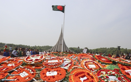 The National Martyrs' Memorial in Dhaka's Savar is covered by flowers for the Liberation War martyrs on Independence Day. Photo: asif mahmud ove